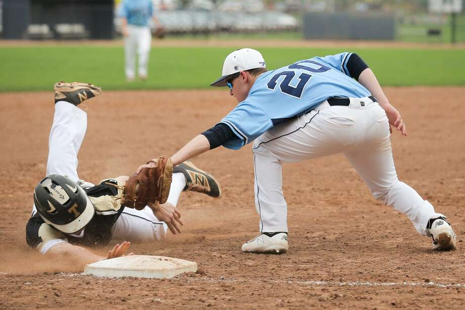 Ethan Leinberger tags out Chris Brown during Wilton's 3-0 loss to Trumbull in Wilton, Conn. on Friday, May 4, 2018. Photo: Chris Palermo / For Hearst Connecticut Media / Norwalk Hour Freelance