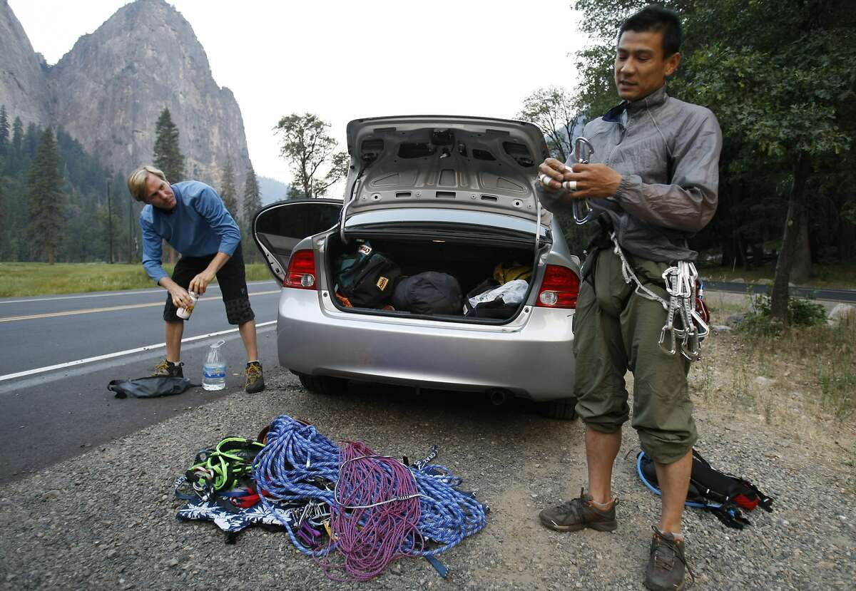Speedclimbers Hans Florine, left, of Lafayette, Calif., and Yugi Hirayama, of Japan prepare their rock climbing equipment for an ascent up Yosemite's El Capitan on June 23, 2008. This was just a practice climb. Later this week, they will attempt a new record of climbing the Nose route of El Capitan to beat the current record of 2 hours, 45 minutes and 45 seconds. Photo by Michael Maloney / The Chronicle