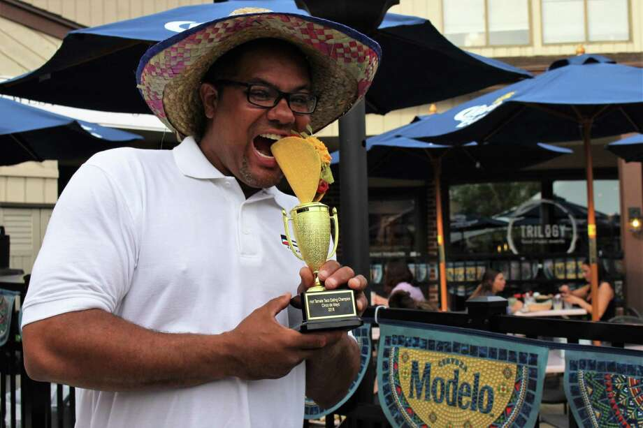 Taco-eating champion Hector Ortiz wins the 5th annual Taco Eating Contest in Seymour. Photo: Jean Falbo /