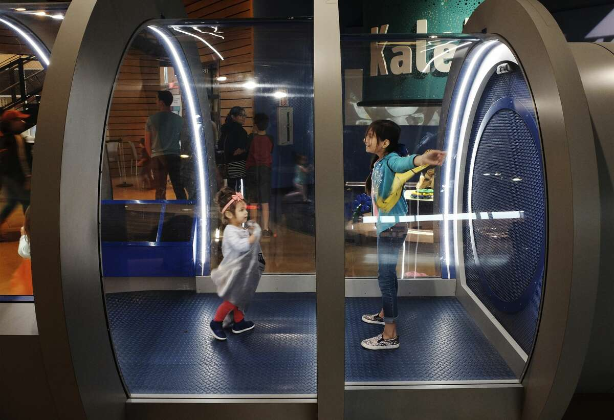 Eres Garza (cq), 11, stands in an interactive wind tunnel with her younger sister, Lady (cq), at the Do-Seum on Friday, May 4, 2018. Area museums around town are open for free as part of the Tricentennial celebration called Arts for All day on Friday. The crowds at The DoSeum were a mix of patrons who knew about the free event which is held on behalf of the city's 300th anniversary. (Kin Man Hui/San Antonio Express-News)