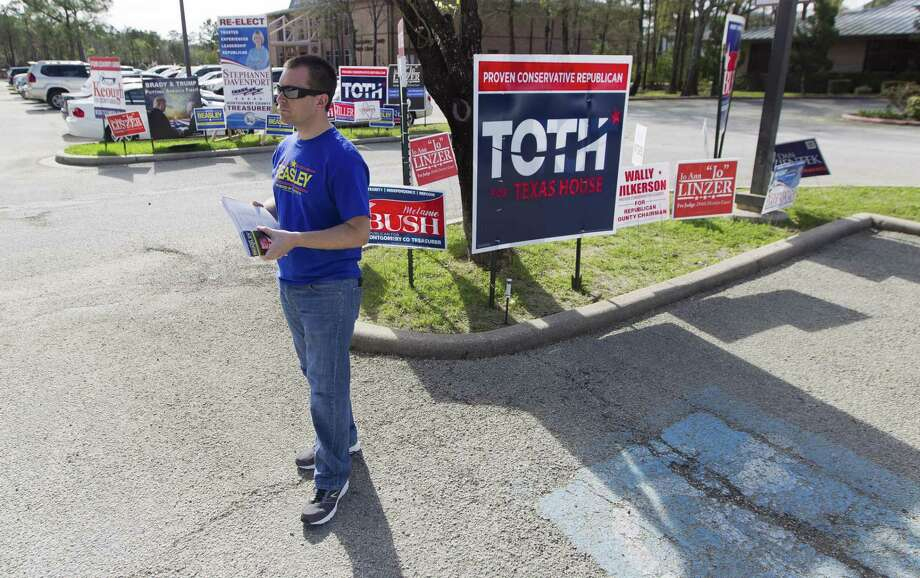 Charles Cobb, a political volunteer with Matt Beasley, candidate for Montgomery County Precinct 3 Justice of the Peace, waits for voters during a slow turnout at the South County Community Center voting location, Tuesday, March 6, 2018. Photo: Jason Fochtman, Staff Photographer / Houston Chronicle / © 2018 Houston Chronicle