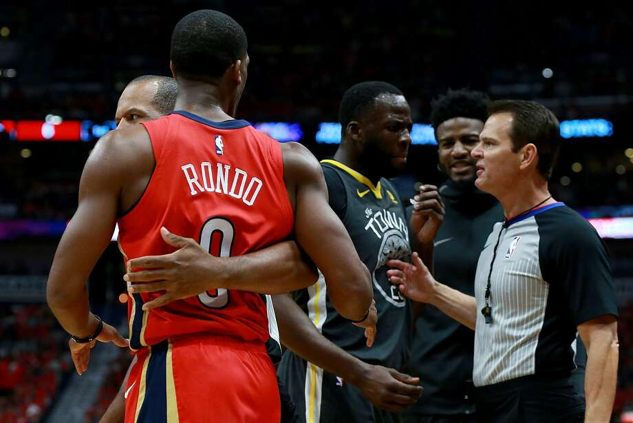 NEW ORLEANS, LA - MAY 04:  Draymond Green #23 of the Golden State Warriors and Rajon Rondo #9 of the New Orleans Pelicans are involved in an altercation during the first half of Game Three of the Western Conference Semifinals of the 2018 NBA Playoffs at the Smoothie King Center on May 4, 2018 in New Orleans, Louisiana. NOTE TO USER: User expressly acknowledges and agrees that, by downloading and or using this photograph, User is consenting to the terms and conditions of the Getty Images License Agreement.  (Photo by Sean Gardner/Getty Images) Photo: Sean Gardner / Getty Images