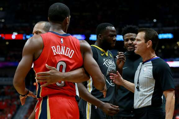 NEW ORLEANS, LA - MAY 04:  Draymond Green #23 of the Golden State Warriors and Rajon Rondo #9 of the New Orleans Pelicans are involved in an altercation during the first half of Game Three of the Western Conference Semifinals of the 2018 NBA Playoffs at the Smoothie King Center on May 4, 2018 in New Orleans, Louisiana. NOTE TO USER: User expressly acknowledges and agrees that, by downloading and or using this photograph, User is consenting to the terms and conditions of the Getty Images License Agreement.  (Photo by Sean Gardner/Getty Images)