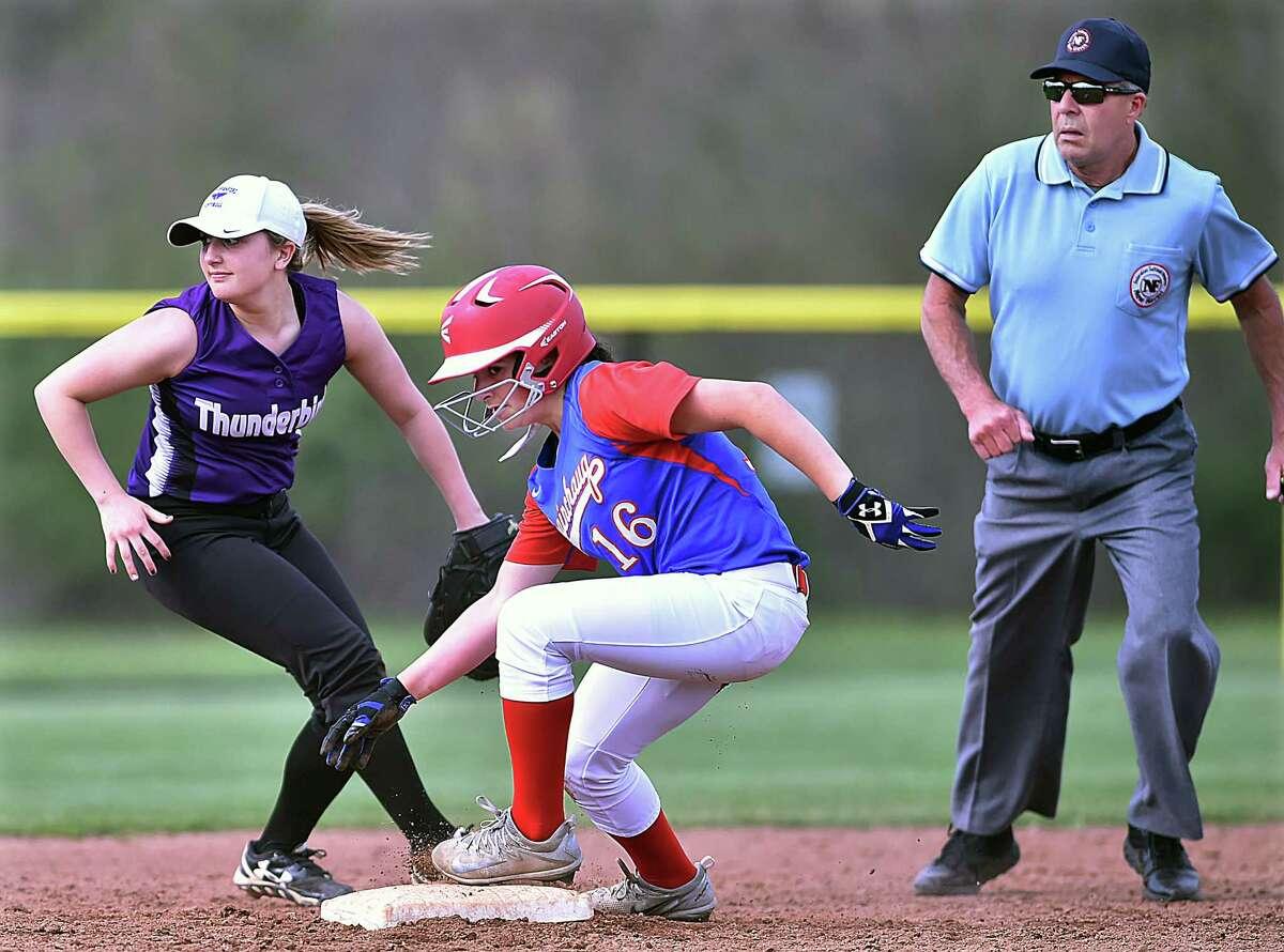 Coginchaug center fielder Isabel Milardo steals third on a missed ball by North Branford second baseman Angelina Ramada, Friday, May 4, 2018, at North Branford High School. North Branford won, 3-2.