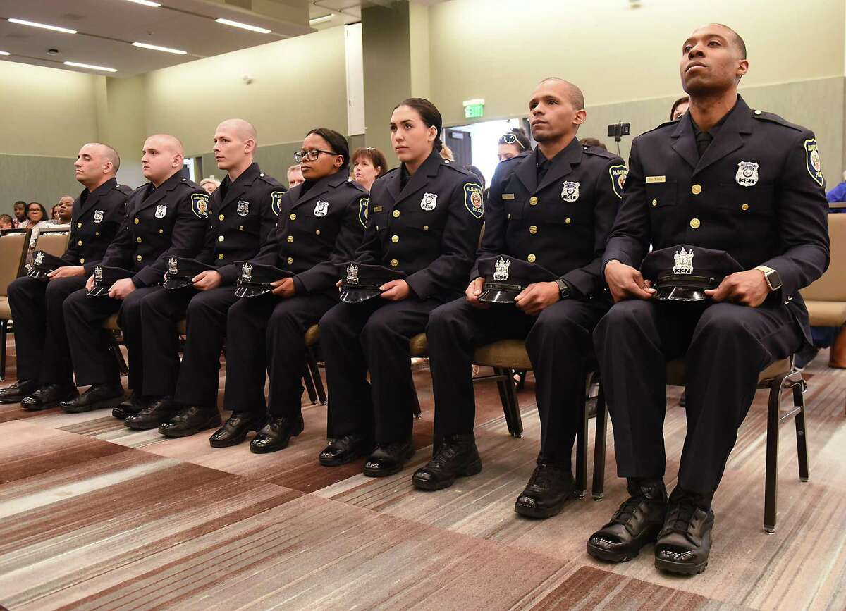 From left, Nicholas Togias, Emiljan Miftari, Dean Johnson, Sarina Hogan, Adrianna Conti, Emmanuel Carter and Shallah Bunch are seven new Albany police officers graduating from the second session of City of Albany Police Academy at the Albany Capital Center on Friday, May 4, 2018 in Albany, N.Y. (Lori Van Buren/Times Union)