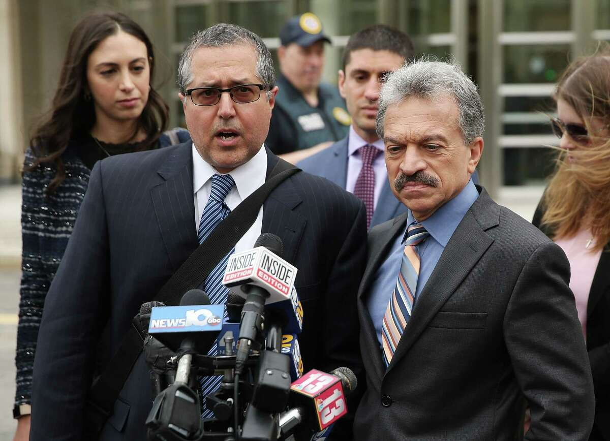 NEW YORK, NY - MAY 04: Legal Council representing Keith Raniere and the group NXIVM Mark Agnifilo and Paul DerOhannesian speak to the media outside the United States Eastern District Court after a bail hearing for actress Allison Mack and NXIVM founder Keith Raniere in relation to the sex trafficking charges on May 4, 2018 in the Brooklyn borough of New York City. Actress Allison Mack, known for her role on 'Smallville', is charged with sex trafficking. Along with alleged cult leader Keith Raniere, prosecutors say Mack recruited women to an upstate New york mentorship group NXIVM that turned them into sex slaves. (Photo by Jemal Countess/Getty Images)