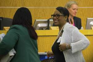 HISD chief academic officer Grenita Lathan (left) speaks with HISD chief of staff Cynthia Wilson (right) following a Houston Independent School District school board meeting, Thursday, March 8, 2018, in Houston. ( Mark Mulligan / Houston Chronicle )
