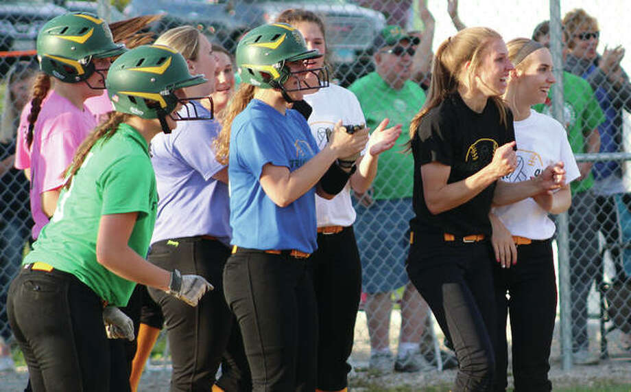 Southwestern's Ashleigh Watts (far right) and Mayci Wilderman (black shirt) head the greeting party of Piasa Birds waiting for Bri Roloff after Roloff's two-out, walk-off RBI single in the ninth inning beat Hillsboro in a South Central Conference softball game Friday in Piasa. Photo:     Greg Shashack | The Telegraph