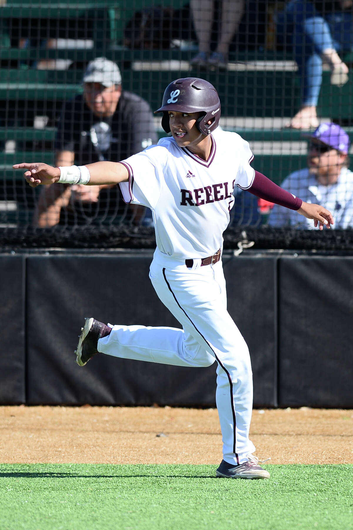 Lee's Junior Alvarez (5) celebrates after scoring a run against El Paso Franklin May 4, 2018, at McCanlies Field in Odessa. James Durbin/Reporter-Telegram