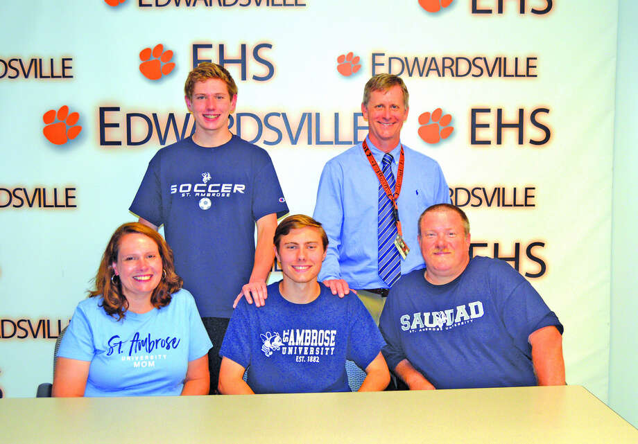 Edwardsville senior Jacob Mulvihill will play soccer at St. Ambrose University. In the front row, from left to right, are mother Jenny Mulvihill, Jacob Mulvihill and father John Mulvihill. In the back row, from left to right, are brother J.D. Mulvihill and EHS coach Mark Heiderscheid.