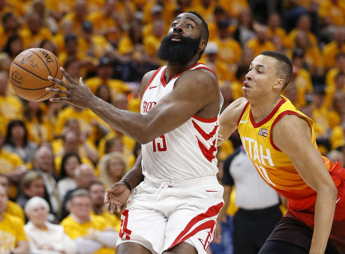 Houston Rockets guard James Harden (13) makes a no-look pass after taking the ball past Utah Jazz guard Dante Exum (11) during the first half of Game 3 of the NBA second-round playoff series at Vivint Smart Home Arena Friday, May 4, 2018 in Salt Lake City. (Michael Ciaglo / Houston Chronicle)