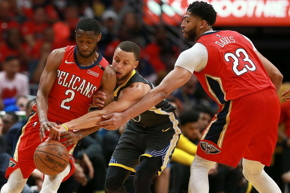 NEW ORLEANS, LA - MAY 04: Stephen Curry #30 of the Golden State Warriors steals the ball from Ian Clark #2 of the New Orleans Pelicans during the second half of Game Three of the Western Conference Semifinals of the 2018 NBA Playoffs at the Smoothie King Center on May 4, 2018 in New Orleans, Louisiana. NOTE TO USER: User expressly acknowledges and agrees that, by downloading and or using this photograph, User is consenting to the terms and conditions of the Getty Images License Agreement. (Photo by Sean Gardner/Getty Images)