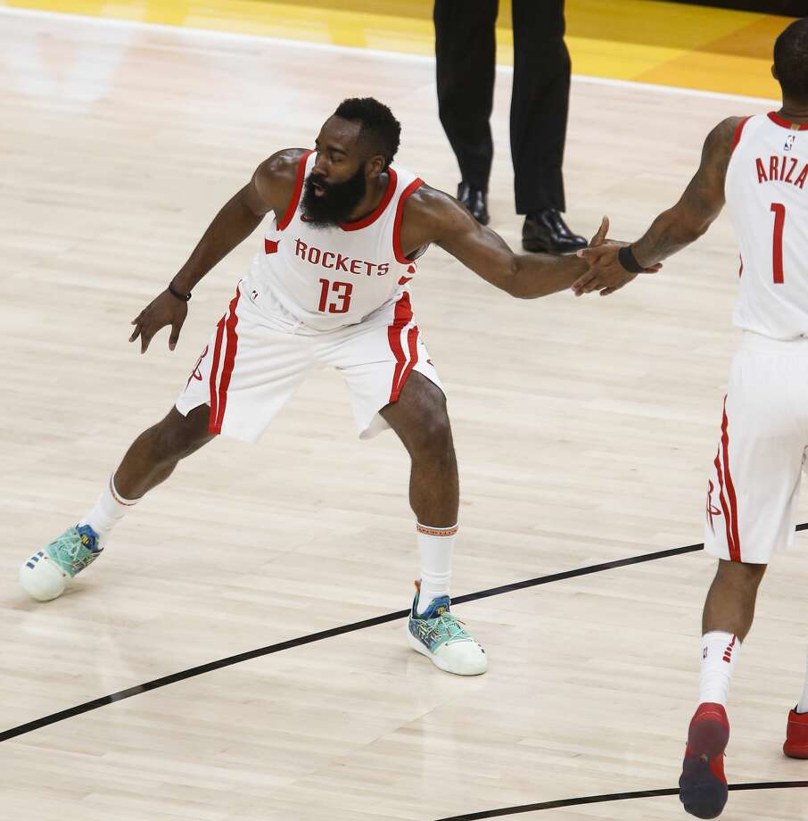 Houston Rockets guard James Harden (13) high fives forward Trevor Ariza (1) as the Utah Jazz call a time out during the first half of Game 3 of the NBA second-round playoff series at Vivint Smart Home Arena Friday, May 4, 2018 in Salt Lake City. (Michael Ciaglo / Houston Chronicle) Photo: Michael Ciaglo/Houston Chronicle