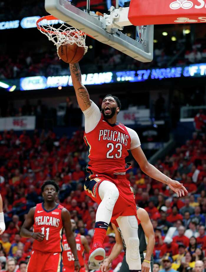 87b14dd875ac New Orleans Pelicans forward Anthony Davis (23) slam-dunks during the  second half