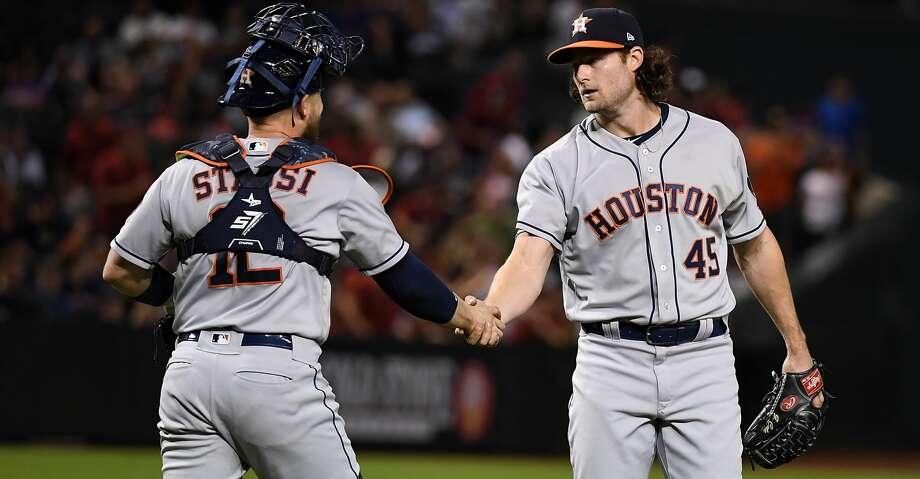 PHOENIX, AZ - MAY 04:  Gerrit Cole #45 and Max Stassi #12 of the Houston Astros celebrate an 8-0 win against the Arizona Diamondbacks at Chase Field on May 4, 2018 in Phoenix, Arizona.  (Photo by Norm Hall/Getty Images) Photo: Norm Hall/Getty Images