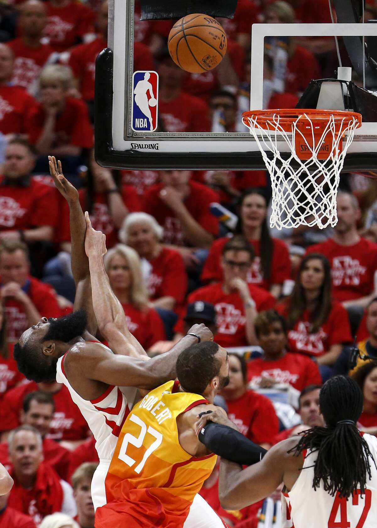 Houston Rockets guard James Harden (13) is fouled by Utah Jazz center Rudy Gobert (27) as he takes a shot during the second half of Game 3 of the NBA second-round playoff series at Vivint Smart Home Arena Friday, May 4, 2018 in Salt Lake City. (Michael Ciaglo / Houston Chronicle)