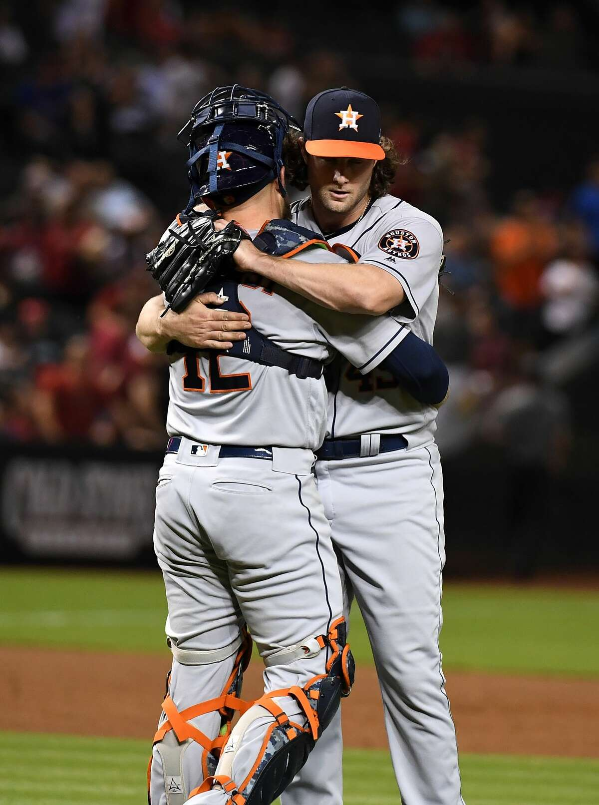 PHOENIX, AZ - MAY 04: Gerrit Cole #45 and Max Stassi #12 of the Houston Astros celebrate an 8-0 win against the Arizona Diamondbacks at Chase Field on May 4, 2018 in Phoenix, Arizona. (Photo by Norm Hall/Getty Images)
