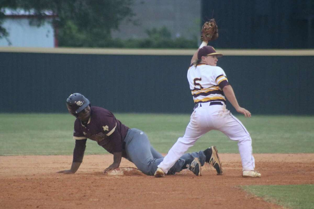 Deer Park second baseman Blaine Holden holds up his glove after tagging out Summer Creek's Joseph Hill in the second inning. The Bulldogs only had six baserunners all night long.