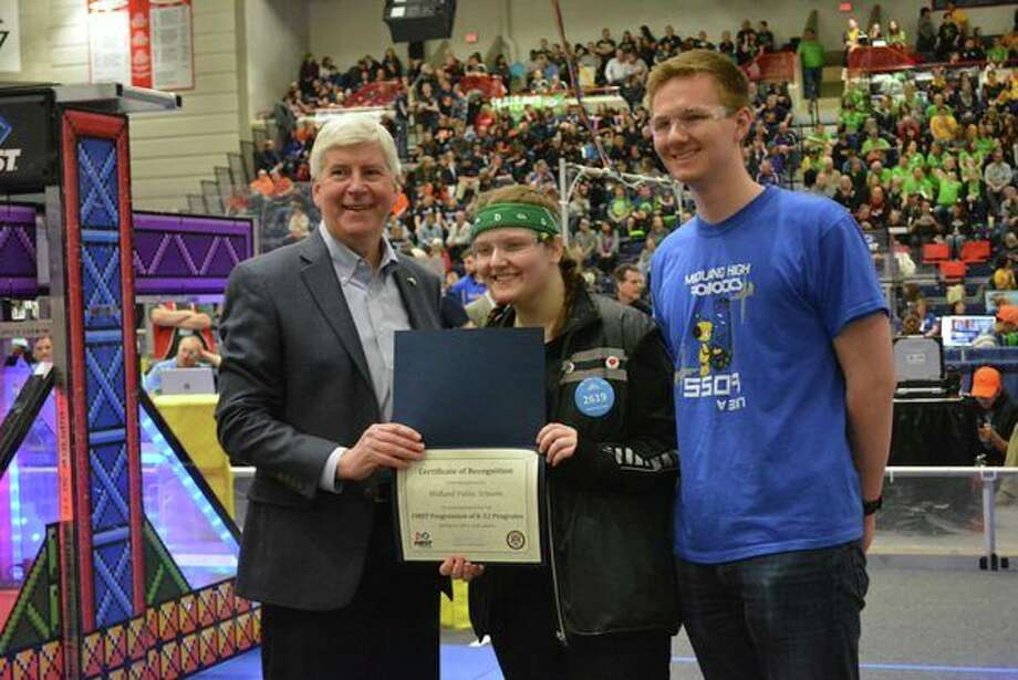 The H.H. Dow High and Midland High teams receive a FIRST Robotics Award from Gov. Rick Snyder. (Photo provided)