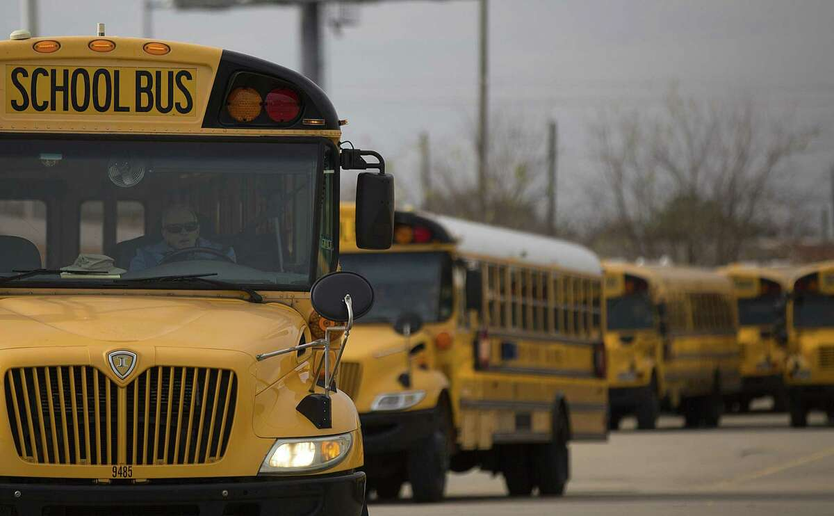 A Houston ISD bus driver leaves the HISD Northwest Shop on the 6300 block of Pinemont Drive as he headed out on his afternoon route.