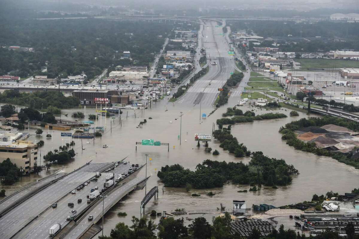 Interstate 10 at Market is shown blocked by floodwaters from Tropical Storm Harvey on Tuesday, Aug. 29, 2017, in Houston. ( Brett Coomer / Houston Chronicle )