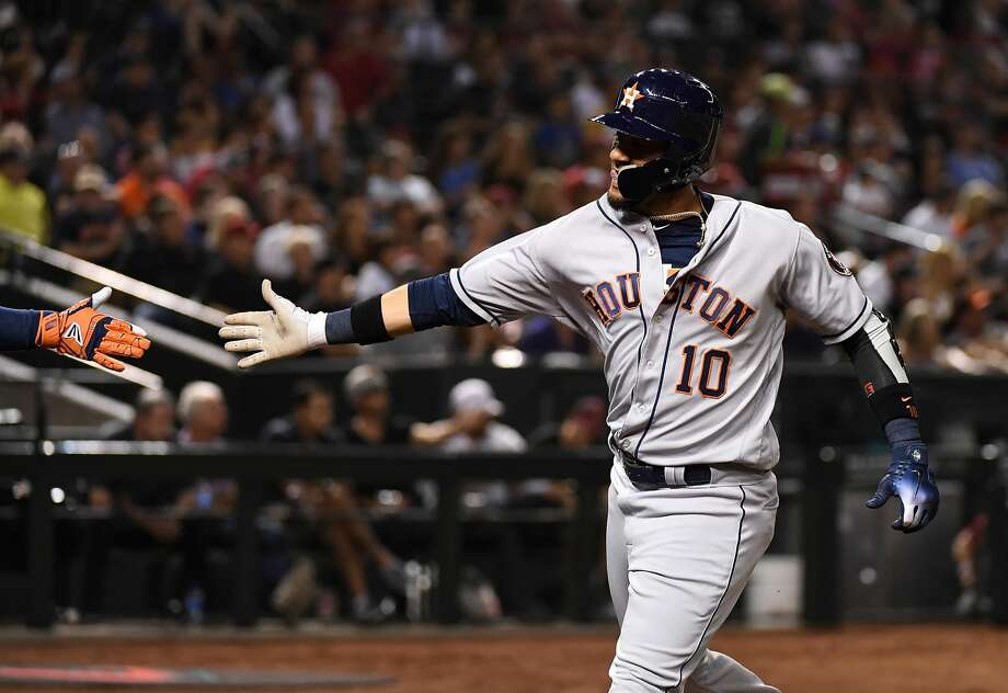 PHOENIX, AZ - MAY 04:  Yulieski Gurriel #10 of the Houston Astros gets a high five after scoring a run on a single by Josh Reddick #22 during the fourth inning against the Arizona Diamondbacks at Chase Field on May 4, 2018 in Phoenix, Arizona.  (Photo by Norm Hall/Getty Images) Photo: Norm Hall/Getty Images