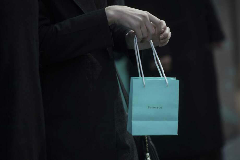 304e17f738 A shopper carries a Tiffany   Co. bag outside the company s flagship store  on Fifth