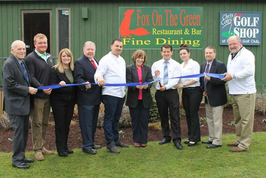 Fox on the Green Restaurant & Bar held a grand opening April 19 at Portland Golf Course. From left are Middlesex County Chamber of Commerce President Larry McHugh, golf course manager Jack Kelly, Laurie Kelly, Chamber Vice Chairman Jay Polke, Fox on the Green's Fico Cecunjanin, First Selectwoman Susan Bransfield, Fox on the Greens Alex Cecunjanin, Anela Cecunjanin, Chamber Chairman Rick Morin and golf course owner John Kelly. Photo: Contributed Photo