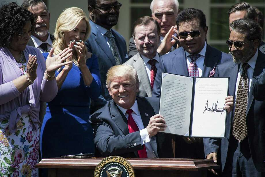 President Trump signs an Executive Order on the Establishment of a White House Faith and Opportunity Initiative during a National Day of Prayer event in the Rose Garden of the White House on Thursday. Trump said the order would expand government grants to and partnerships with faith-based groups. MUST CREDIT: Washington Post photo by Jabin Botsford Photo: Jabin Botsford, The Washington Post / The Washington Post / The Washington Post