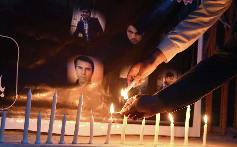 Pakistani journalists light candles during a vigil for Afghan journalists killed in a targeted suicide bombing, to mark World Press Freedom Day in Quetta on May 3, 2018. Ten journalists were killed April 30, including Agence France-Presse chief photographer Shah Marai, in attacks in Kabul that sparked outrage around the world and underscored the dangers faced by Afghan media. Photo: BANARAS KHAN, Contributor / AFP/Getty Images / AFP or licensors