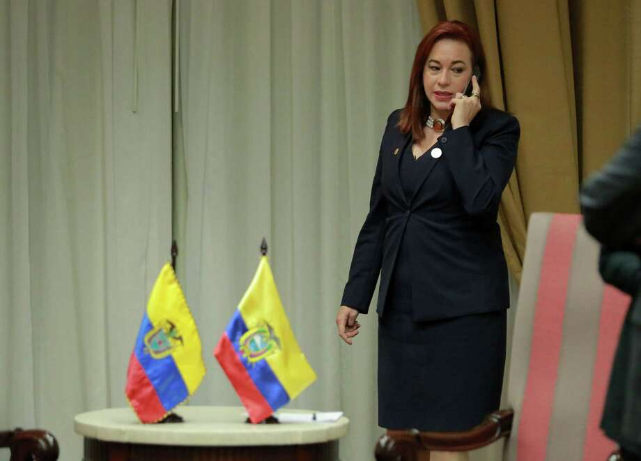 Ecuador's Foreign Minister Maria Fernanda Espinosa speaks on her mobile phone before a meeting with Colombian President Juan Manuel Santos (out of frame) to discuss the case of the journalist team killed in Ecuador, in the sidelines of the Summit of the Americas, in Lima, on April 13, 2018. Ecuador's President Lenin Moreno confirmed the deaths of three members of a journalist team kidnapped by renegade Colombian rebels -- and launched a retaliatory military operation in the area where they were snatched. / AFP PHOTO / Luka GONZALESLUKA GONZALES/AFP/Getty Images Photo: LUKA GONZALES, Contributor / AFP/Getty Images / AFP or licensors