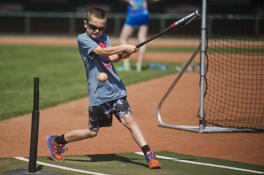 Corbin Frazier of Midland, 9, hits the ball during the annual Pitch, Hit and Run Competition on Saturday, May 5, 2018 at Dow Diamond. (Katy Kildee/kkildee@mdn.net) Photo: (Katy Kildee/kkildee@mdn.net)