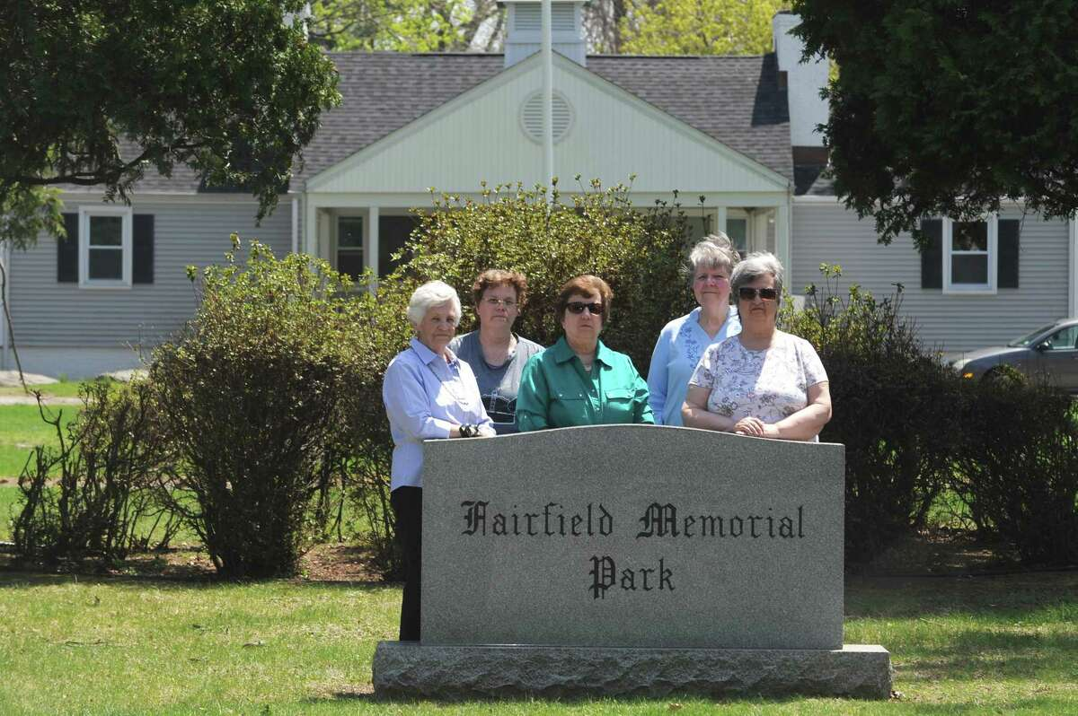 From left, Dody Green, Cheryll Duerk, Jeanine Valentine, Betsy Cologan and Rita Valentine pose for a photo outside the Fairfield Memorial Park Cemetery on Oaklawn Ave. in Stamford, Conn. on Thursday, May 3, 2018. The women, graveowners at Fairfield Memorial Park Cemetery, have complained about the poor conditions of the cemetery.