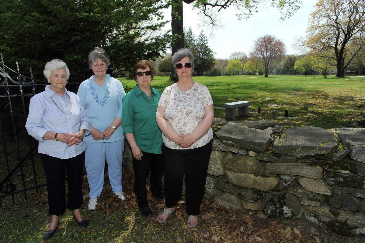 From left, Dody Green, Betsy Colohan, Jeanine Valentine and Rita Valentine pose for a photo outside the Fairfield Memorial Park Cemetery on Oaklawn Ave. in Stamford, Conn. on Thursday, May 3, 2018. The women, graveowners at Fairfield Memorial Park Cemetery, have complained about the poor conditions of the cemetery.