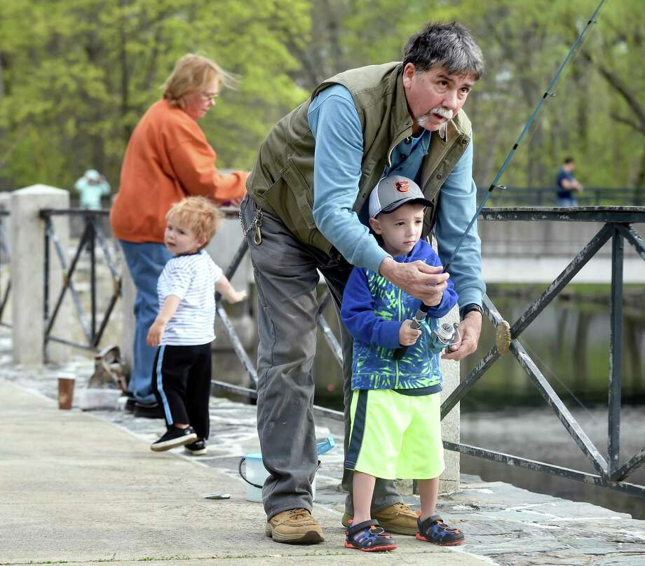 John Mickolyzck of Milford fishes with his grandson, Joseph Alickey, 4, in the Milford Striped Bass Club Annual Trout Derby at the Milford Duck Pond behind City Hall on May 5, 2018. Photo: Arnold Gold / New Haven Register / New Haven Register