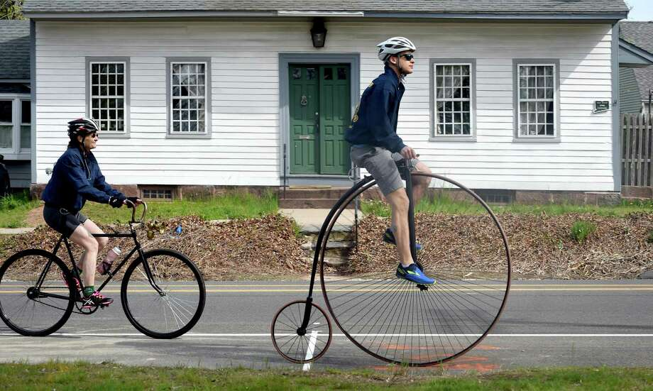 Alyson Blanck (left) of Orange on a Pierce Arrow bicycle and her son, Nyle Blanck, on an 1886 Columbia Expert penny-farthing bicycle ride up Main Street in East Haven on May 5, 2018.  They were with the Wheelmen who rode antique bicycles round trip from Lighthouse Point Park in New Haven to the East Haven Historical Society Museum. Photo: Arnold Gold / New Haven Register / New Haven Register