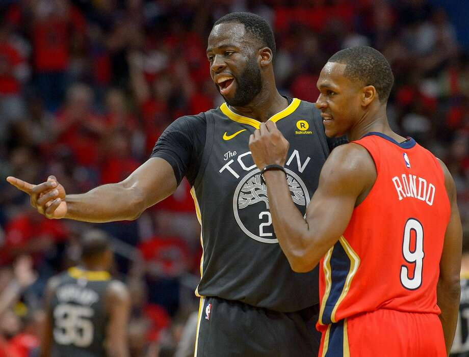 Golden State Warriors forward Draymond Green (23) and New Orleans Pelicans guard Rajon Rondo (9) exchange words during the second half of Game 3. Photo: Advocate Staff Photo By MATTHEW HINTON, The Advocate