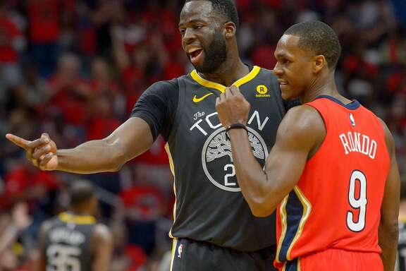 Golden State Warriors forward Draymond Green (23) and New Orleans Pelicans guard Rajon Rondo (9) exchange words during the second half of game 3 of the conference semifinal NBA playoffs at the Smoothie King Center in New Orleans, La. Friday, May 4, 2018.
