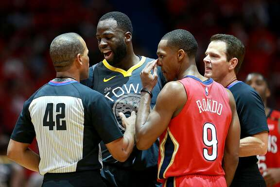 NEW ORLEANS, LA - MAY 04: Referee Eric Lewis #42 issues Rajon Rondo #9 of the New Orleans Pelicans a technical foul after an altercation with Draymond Green #23 of the Golden State Warriors during the second half of Game Three of the Western Conference Semifinals of the 2018 NBA Playoffs at the Smoothie King Center on May 4, 2018 in New Orleans, Louisiana. NOTE TO USER: User expressly acknowledges and agrees that, by downloading and or using this photograph, User is consenting to the terms and conditions of the Getty Images License Agreement.  (Photo by Sean Gardner/Getty Images)