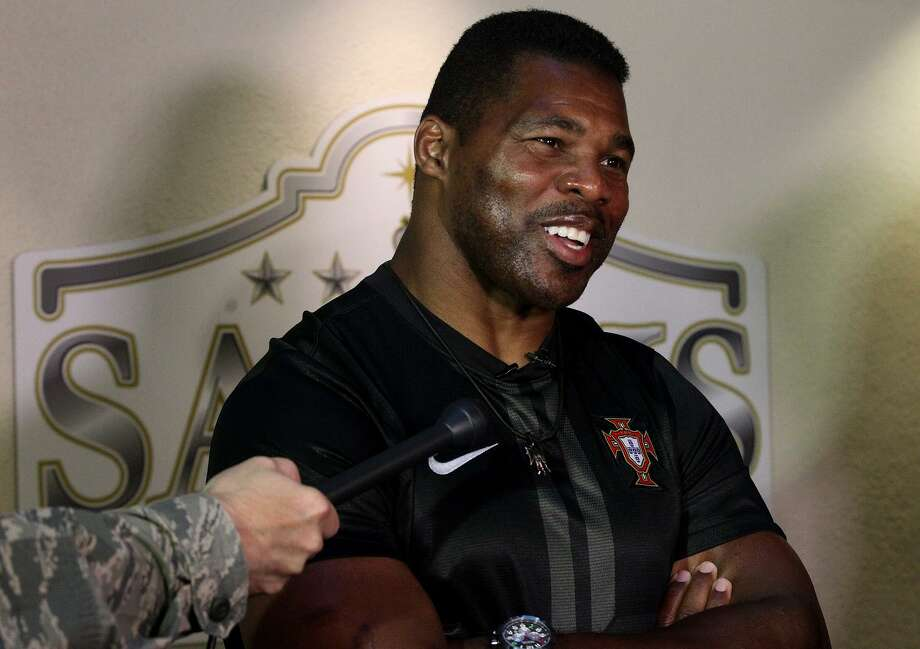 Former Dallas Cowboy and 1982 Heisman Trophy winner Herschel Walker will tee it up at the Walter Camp Celebrity Golf Classic May 14 at The Course at Yale. Photo: John Davenport / San Antonio Express-News / ©San Antonio Express-News/Photo may be sold to the public