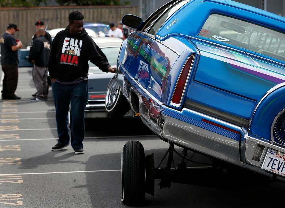 A 1995 Cadillac Fleetwood is displayed at the Cinco de Mayo lowrider car show at John O'Connell High School in San Francisco. Photo: Photos By Paul Chinn / The Chronicle