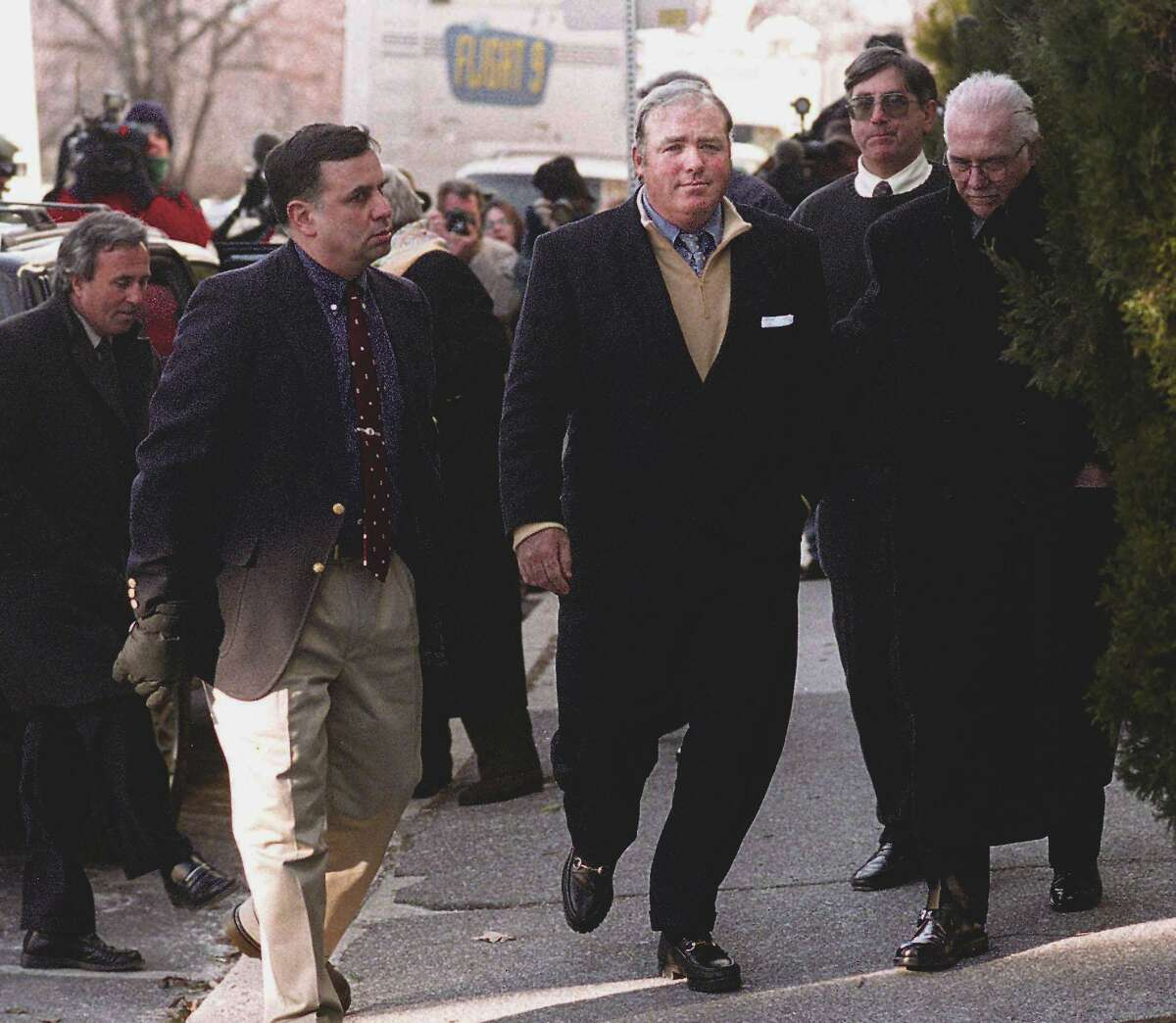 Michael Skakel, center, is led into Greenwich police headquarters by Frank Garr, right, where he was arrested and processed for the murder of Martha Moxley which occured on Oct 30th, 1975. Garr was the lead Greenwich police investigator on the case. At the far left is Skakel's lawyer, Mickey Sherman.