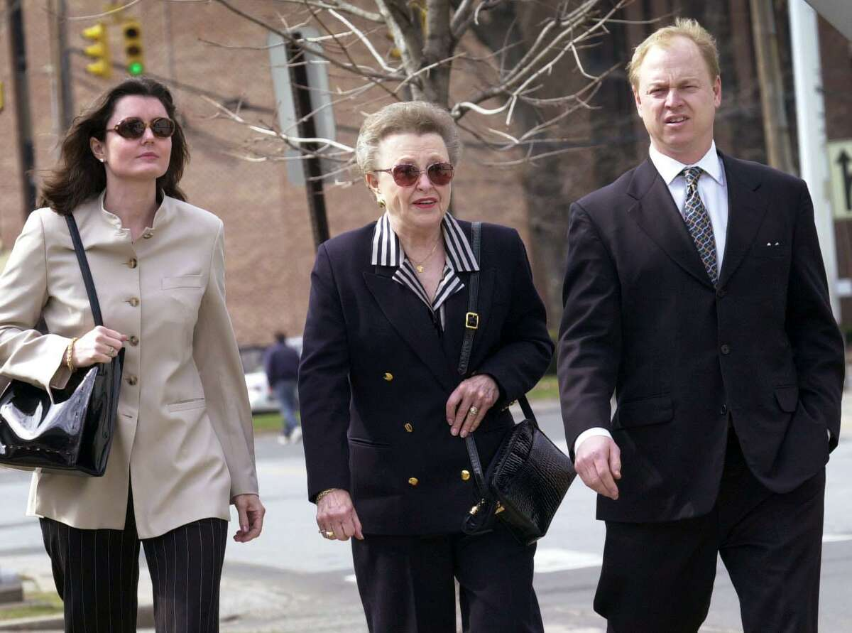 Dorthy Moxley center, with her son John Moxley right and his wife Cara Moxley left, leave the Stamford Court in Stamford Conn. Tuesday, March 14, 2000, after a court hearing of Michael Skakel.