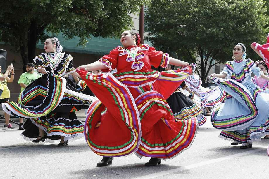 Members from Las Americas Ballet Folklorico perform during a Cinco de Mayo parade presented by LULAC District 8 in Downtown Houston, TX on Saturday, May 5, 2018. Photo: Tim Warner, Freelance / For The Chronicle / Houston Chronicle