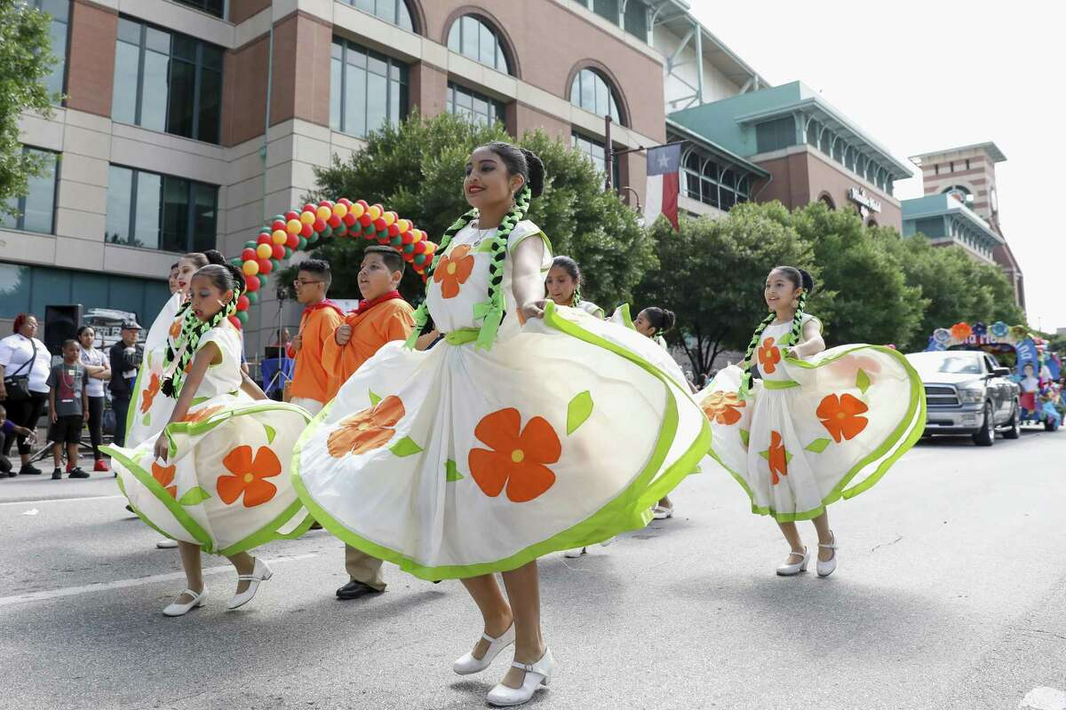 Members of Grupo Folklorico Herencia Mexicana perform during a Cinco de Mayo parade presented by LULAC District 8 in Downtown Houston, TX on Saturday, May 5, 2018.