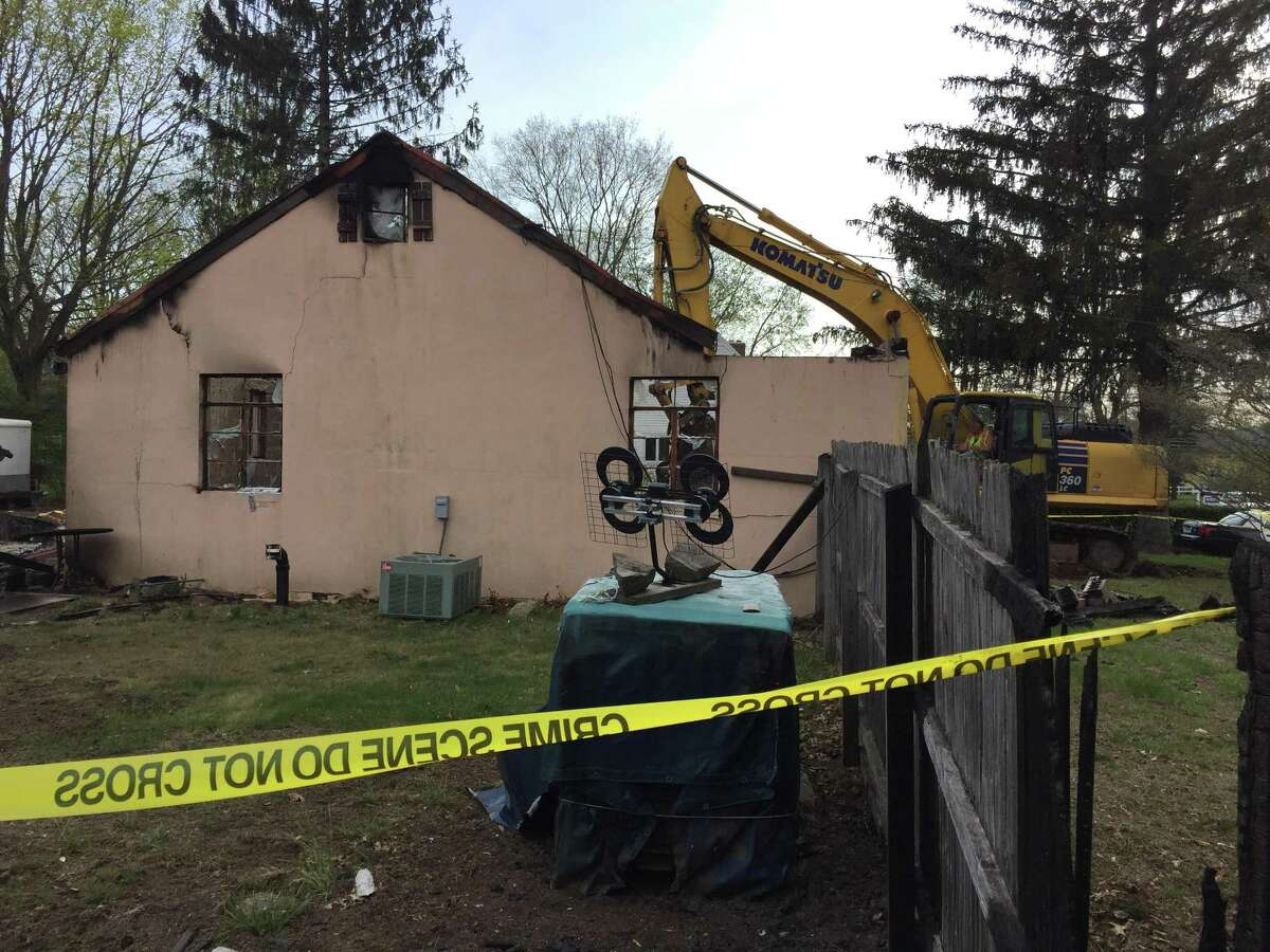 Demolition begins on the house at 385 Quinnipiac Ave. that was the scene of a hostage situation and explosion Wednesday, May, 2, 2018.