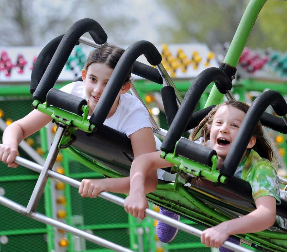 Greenwich residents, Carly Tomer, left, and her sister, Presley Tomer, reacted while on an amusement ride during the North Mianus Pow Wow at the North Mianus School in Greenwich, Conn., Saturday, May 5, 2018. The Pow Wow has been a spring-time tradition since 1946 and is the school's biggest fundraiser with money raised going toward curriculum enrichment programs. Photo: Bob Luckey Jr. / Hearst Connecticut Media / Greenwich Time