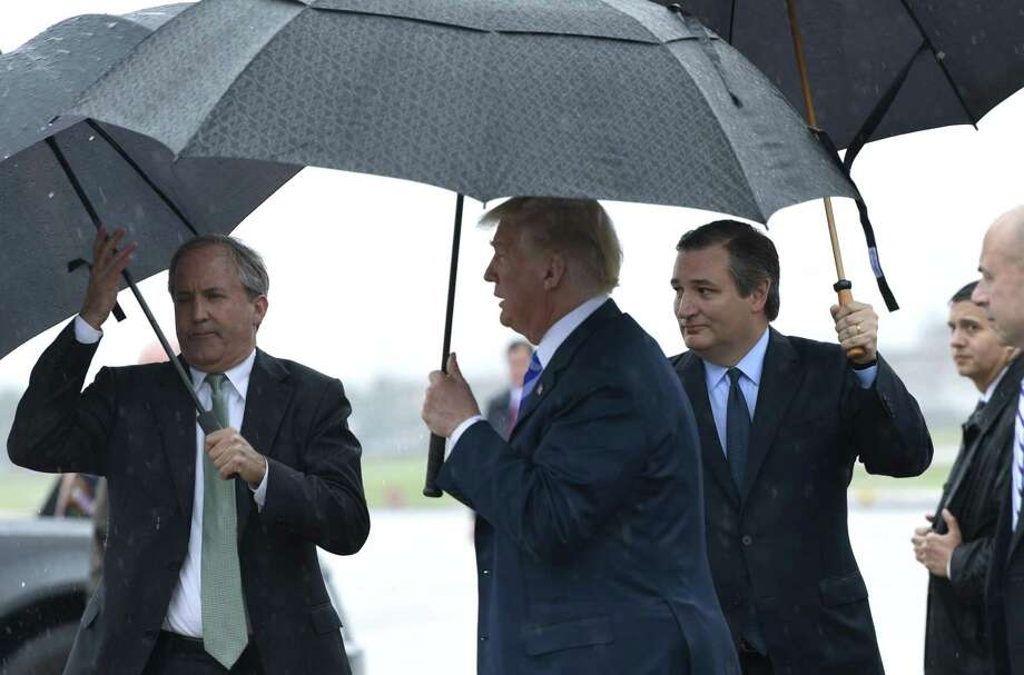 Sen. Ted Cruz, R-Texas, follows behind President Donald Trump as Trump arrives via Air Force One at Dallas Love Field, Friday, May 4, 2018. Trump is in Dallas to address the NRA convention.