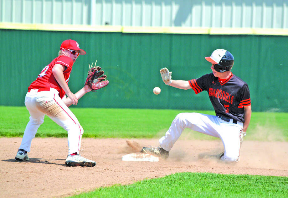 Edwardsville junior Blake Burris, right, steals second base during the fourth inning of Saturday's game against Chatham Glenwood in the 12th annual Tiger Classic at Tom Pile Field.