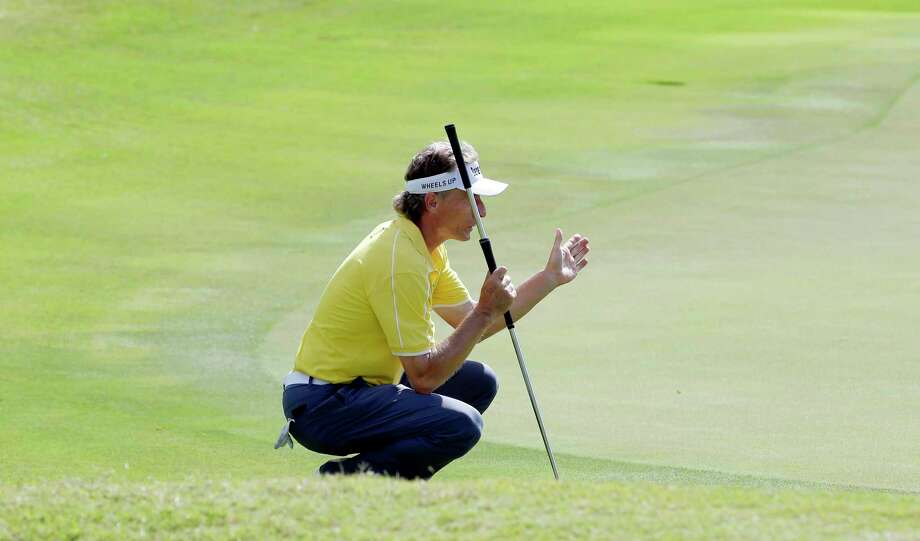 Leader Bernhard Langer uses his hands as he studies the 18th green before putting during the second round of the Insperity Invitational at the The Woodlands Country Club Saturday, May 5, 2018, in The Woodlands, TX. (Michael Wyke / For the  Chronicle) Photo: Michael Wyke, Freelance / © 2018 Houston Chronicle